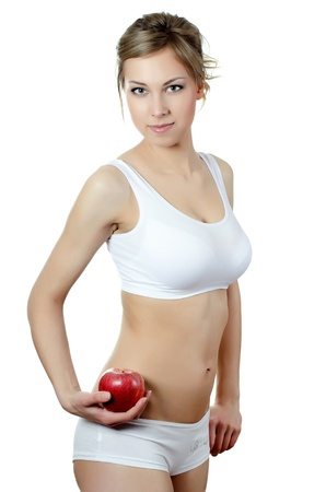 The beautiful girl with apple in hand photo