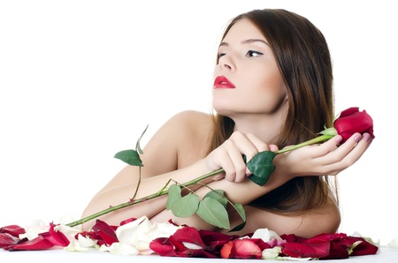 The beautiful girl with petals of roses Stock Photo - 14108491