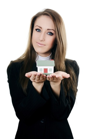 Business woman with small model of house Stock Photo - 14108486