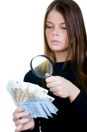 Woman with magnifying glass and euro banknote photo