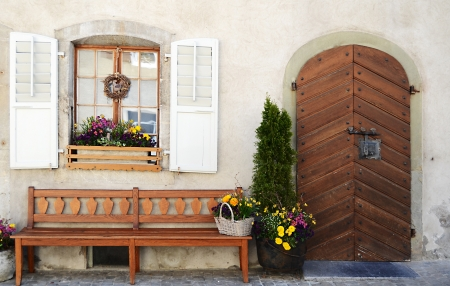 french doors: plants in front of windows and doors Stock Photo