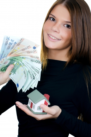 The business woman with the toy house and banknotes photo