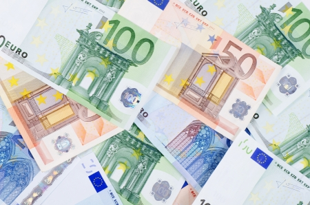 overlapped: New euro banknotes as a background, close-up