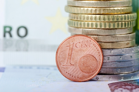 Various scattered Euro currency bills and coins photo