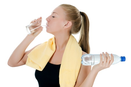 water aerobics: Sports girl with towel and water bottle
