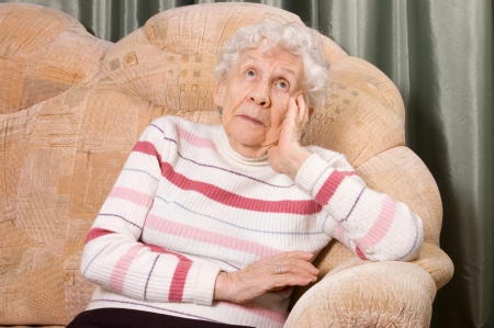 Portrait of the old woman on sofa Stock Photo - 14445092