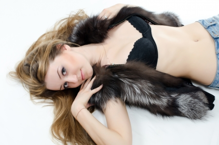 The beautiful girl in a fur vest photo