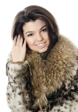 The beautiful girl in a fur hood photo