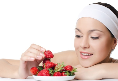 The beautiful woman with a strawberry isolated photo