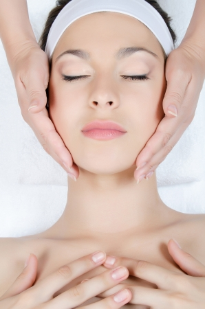 Facial massage to the woman close up Stock Photo - 14445238