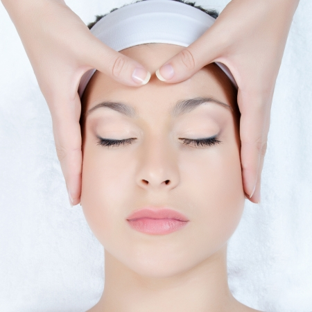body treatment: Facial massage to the woman close up Stock Photo