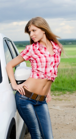 sexy business woman: Beautiful girl stands near to white car Stock Photo