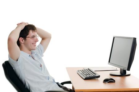 Der Geschäftsmann hinter einem Tisch mit Computer Lizenzfreie Bilder