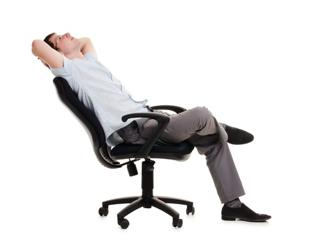 The businessman sits in an armchair isolated photo