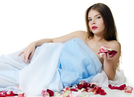 The beautiful girl with petals of roses photo