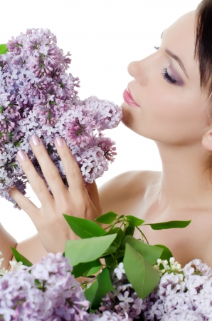 Beautiful woman with flowers of lilac. Skincare Stock Photo - 14845779
