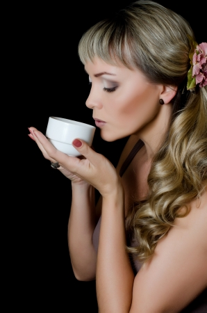 The beautiful elegant woman with coffee cup photo