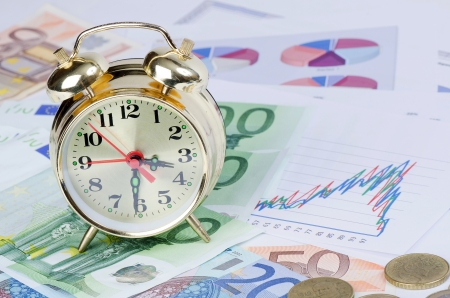 time money: Alarm clock  for euro banknotes