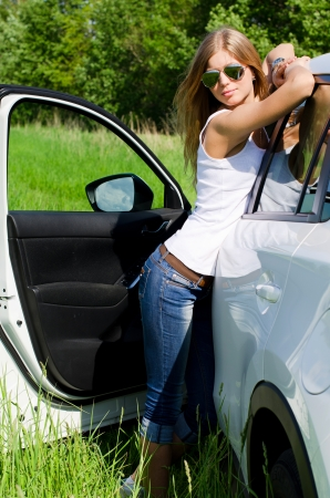 field glass: Beautiful girl stands near to white car Stock Photo