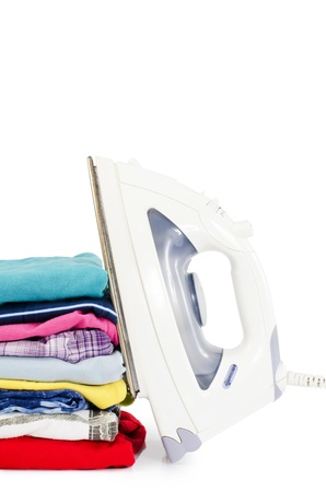 Heap of pure clothes with an iron Stock Photo - 14845359