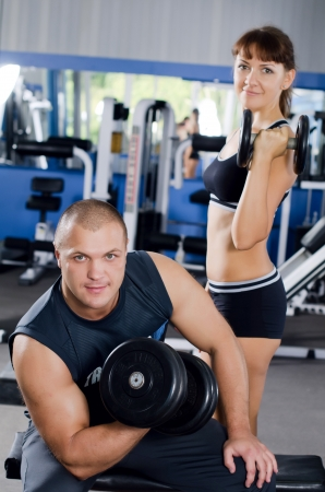The woman with trainer in sports club photo