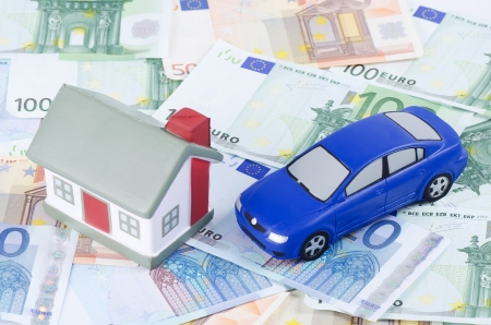 toy house and car for euro banknotes photo