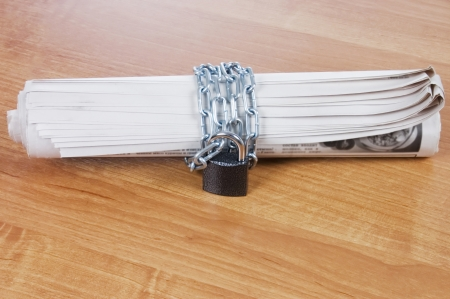 human rights: Newspapers with chains On a wooden table