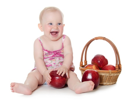 The little baby with red apples isolated photo