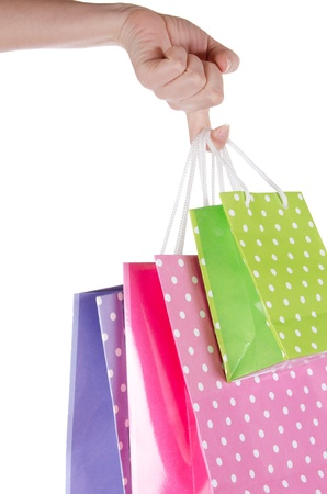 Gift bags in hand isolated on white photo