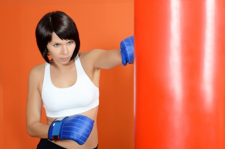 The beautiful woman with a boxing pear photo