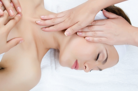 Facial massage to the woman close up Stock Photo