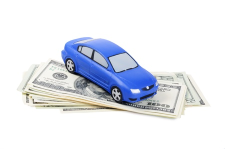 car gas: Toy car for dollar banknotes  as background