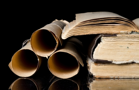 history books: Many scrolls and old books on black