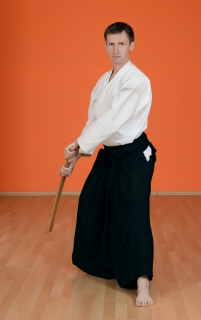 The man carries out exercises aikido photo