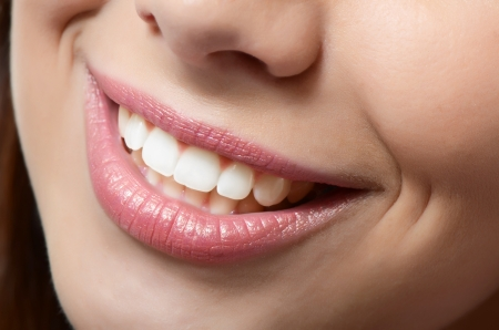 Healthy woman teeth and smile. Close up photo