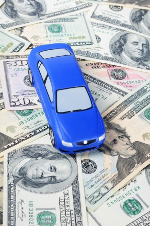 pricey: Toy car for dollar banknotes  as background
