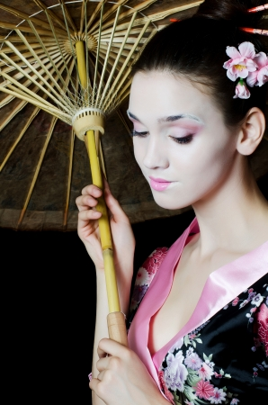The beautiful girl with make-up of Japanese photo