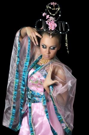 The girl-dancer in costume of the Japanese photo