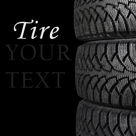 The automobile tire on a black background
