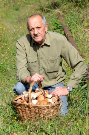 The man with a basket of mushrooms photo