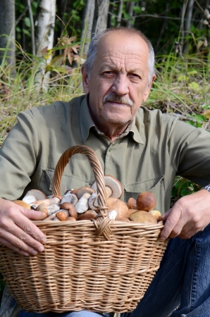 boletus: The man with a basket of mushrooms Stock Photo