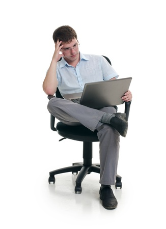 The businessman sits in armchair with laptop photo