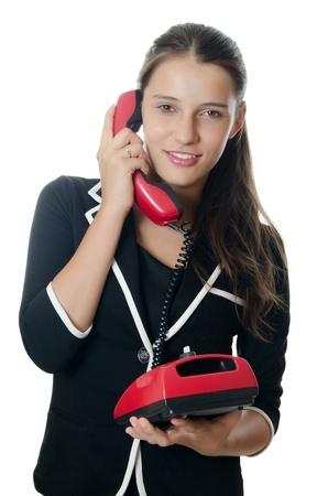speaks: Businesswoman speaks on phone isolated on white