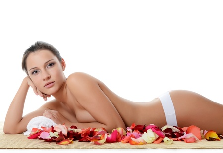 spa towels: Spa beautiful woman with petals of roses Stock Photo