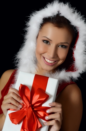 The Christmas girl with boxes of gifts photo