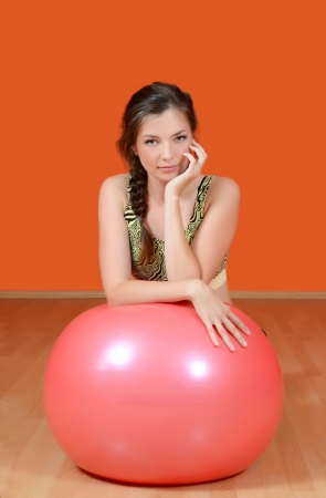 The beautiful  woman with a gymnastic ball photo
