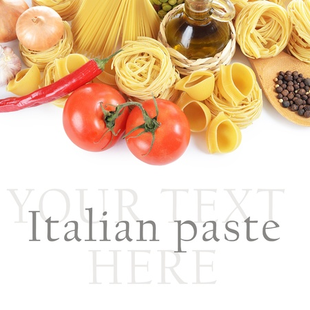 Pasta with spices and vegetables  on white photo