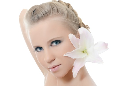 The beautiful woman with a lily flower photo