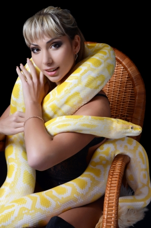 The beautiful woman with big yellow snake photo