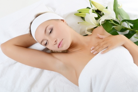 Spa beautiful woman lays with white lily Stock Photo - 17560476